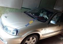 Cần bán lại xe cu Ford Laser năm 2003, màu vàng