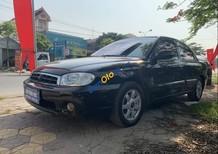 Cần bán xe Kia Spectra sản xuất năm 2004, màu đen