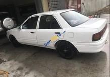 Bán xe Mazda 323 đời 1994, màu trắng, sử dụng cẩn thận nên mọi thứ còn hoạt động tốt