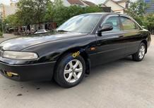 Cần bán lại xe Mazda 626 sản xuất năm 1998, màu đen, nhập khẩu đẹp như mới