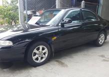 Gia đình cần bán xe Mazda 626 đời 1998, màu đen, nhập khẩu, xe đang hoạt động rất tốt