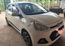 Cần bán xe Hyundai Grand i10 năm 2014, màu trắng, nhập khẩu