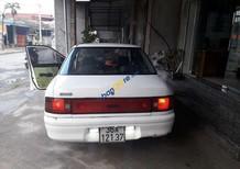 Cần bán xe Mazda 323 MT năm 1996, màu trắng