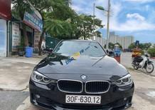 Bán BMW 320i năm sản xuất 2014, màu đen