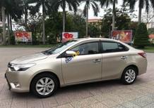 Cần bán lại xe Toyota Vios sản xuất 2014, màu vàng